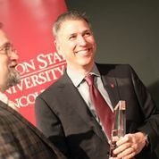 WSUV Chancellor Mel Netzhammer accepts the Plater Award.