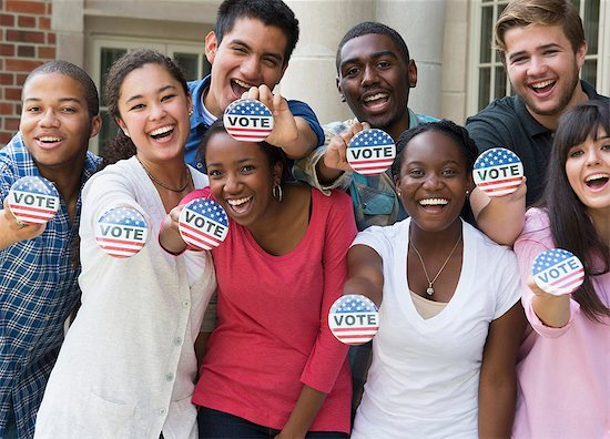 619-07799305 © Masterfile Royalty-Free Model Release: Yes Property Release: No Students holding buttons at voter registration