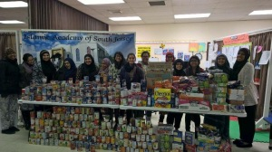 "Volunteers who came together to sort and count over 3,000 cans collected for our ""Feed Their Legacy"" food drive in memory of the 2015 Chapel Hill Shooting victims."